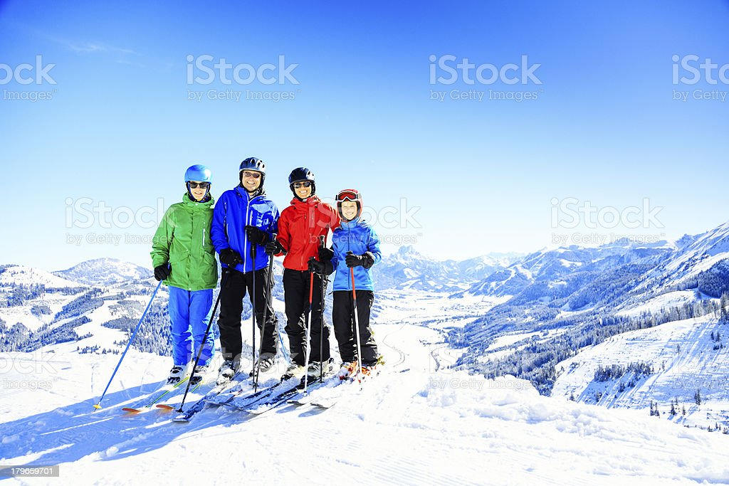 skiing family of four royalty-free stock photo