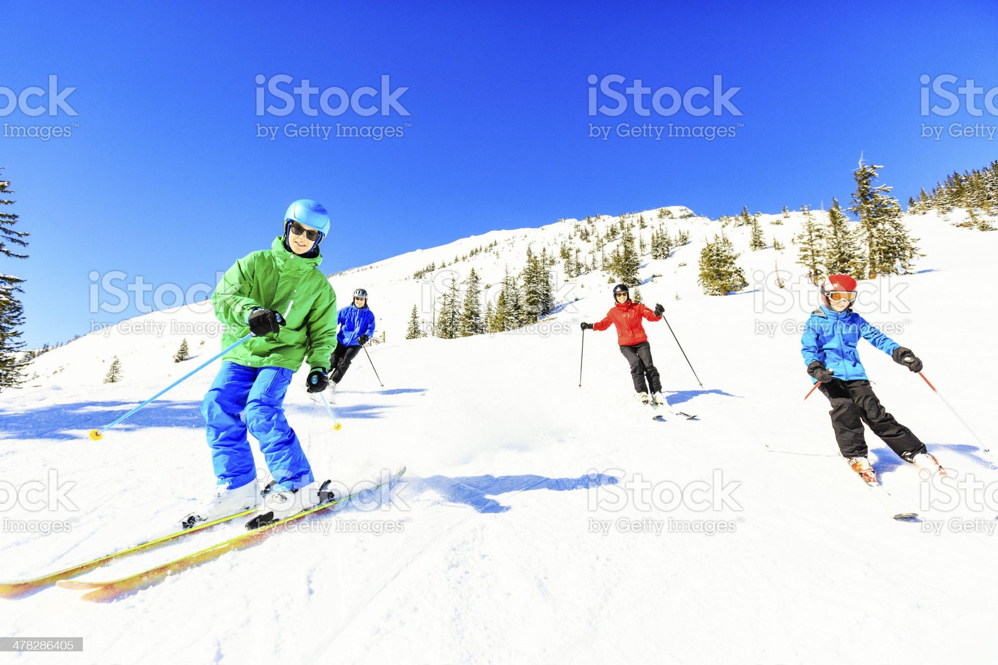 skiing family of four royalty-free stock photo