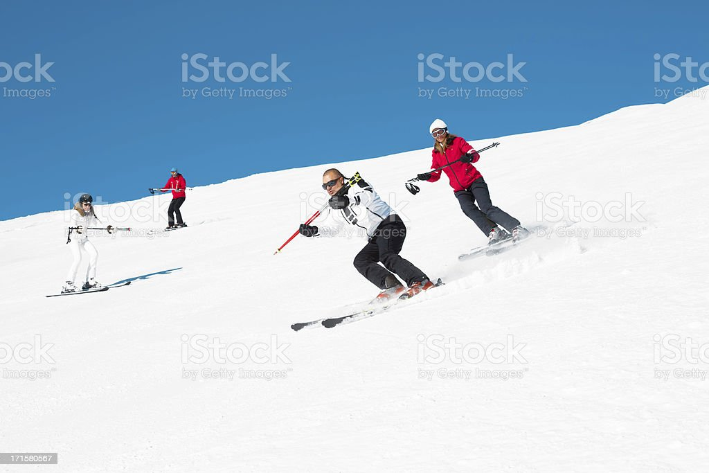 Skiing group on the mountain slope stock photo