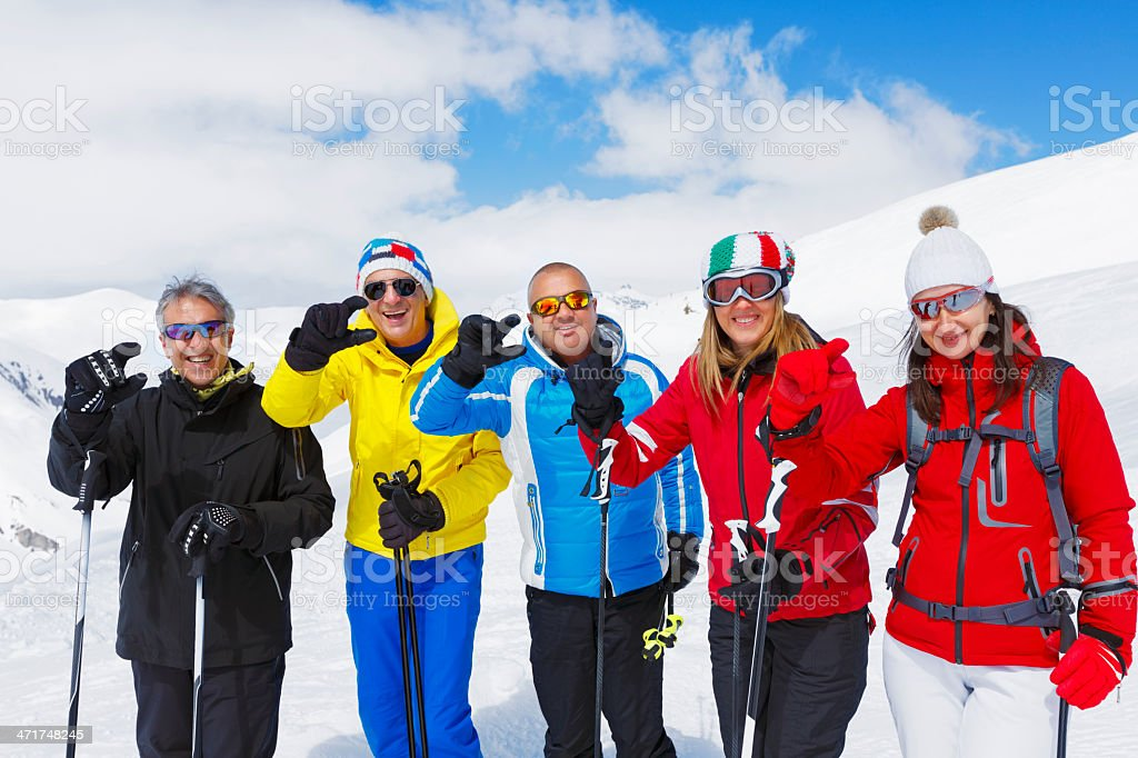 Skiing group on the mountain slope royalty-free stock photo