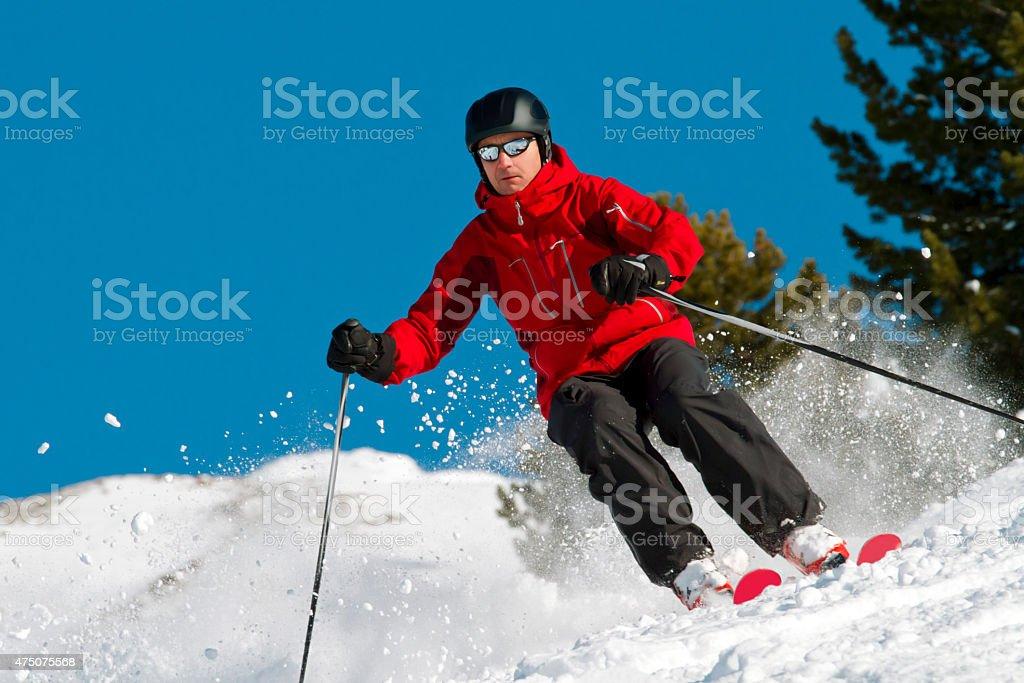 Skiing in fresh powder stock photo