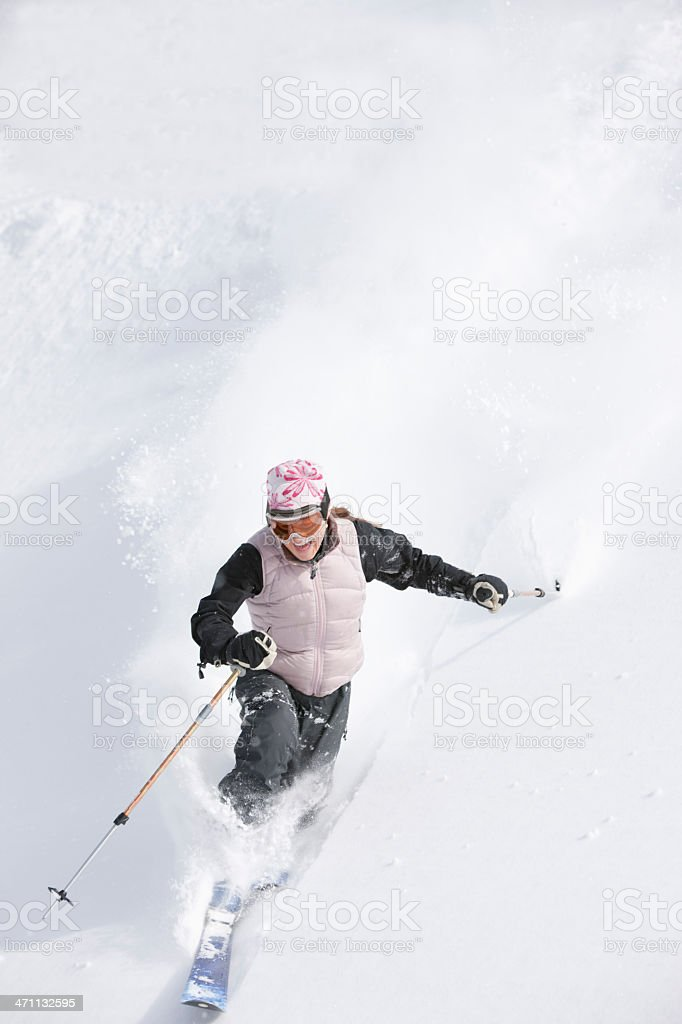 Skiing in fresh powder snow stock photo
