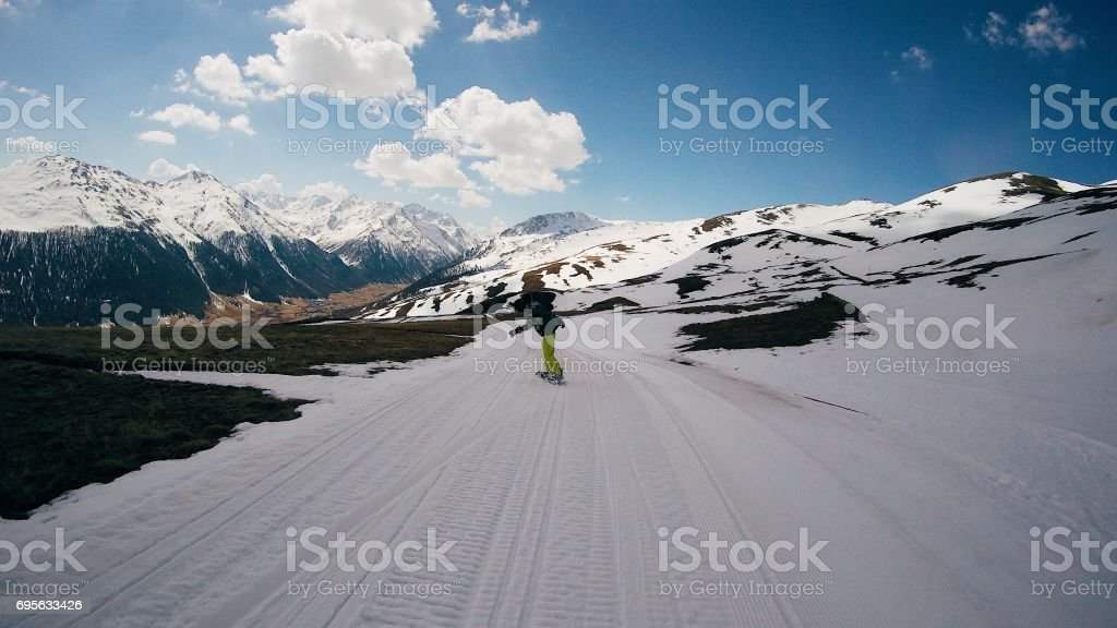 Skiing in an area full of snow. Lonely snowboarder in beautiful...