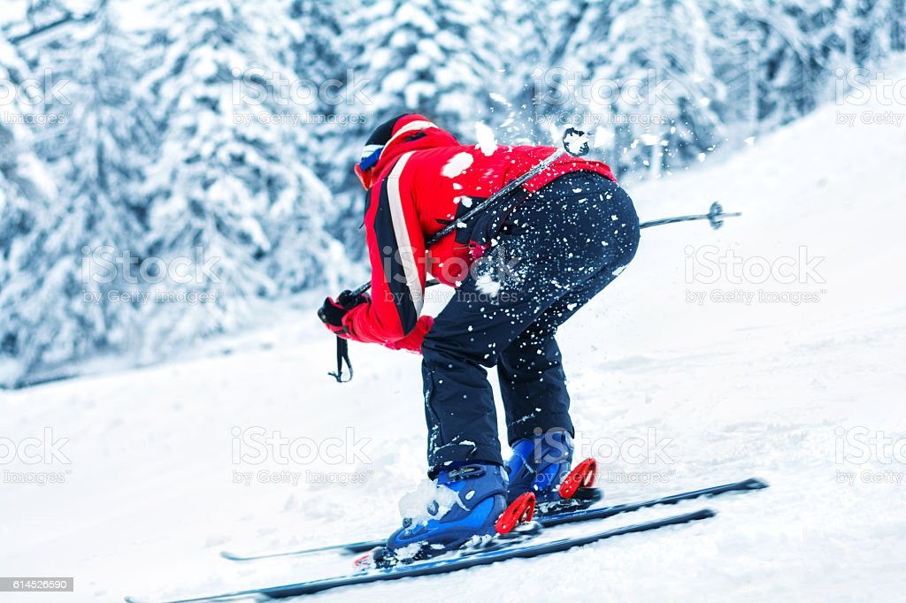 Skiing in motion action stock photo