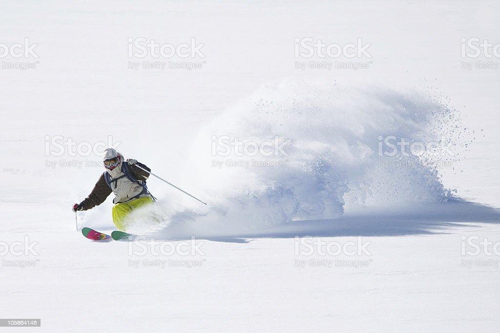 Skiing in powder snow royalty-free stock photo