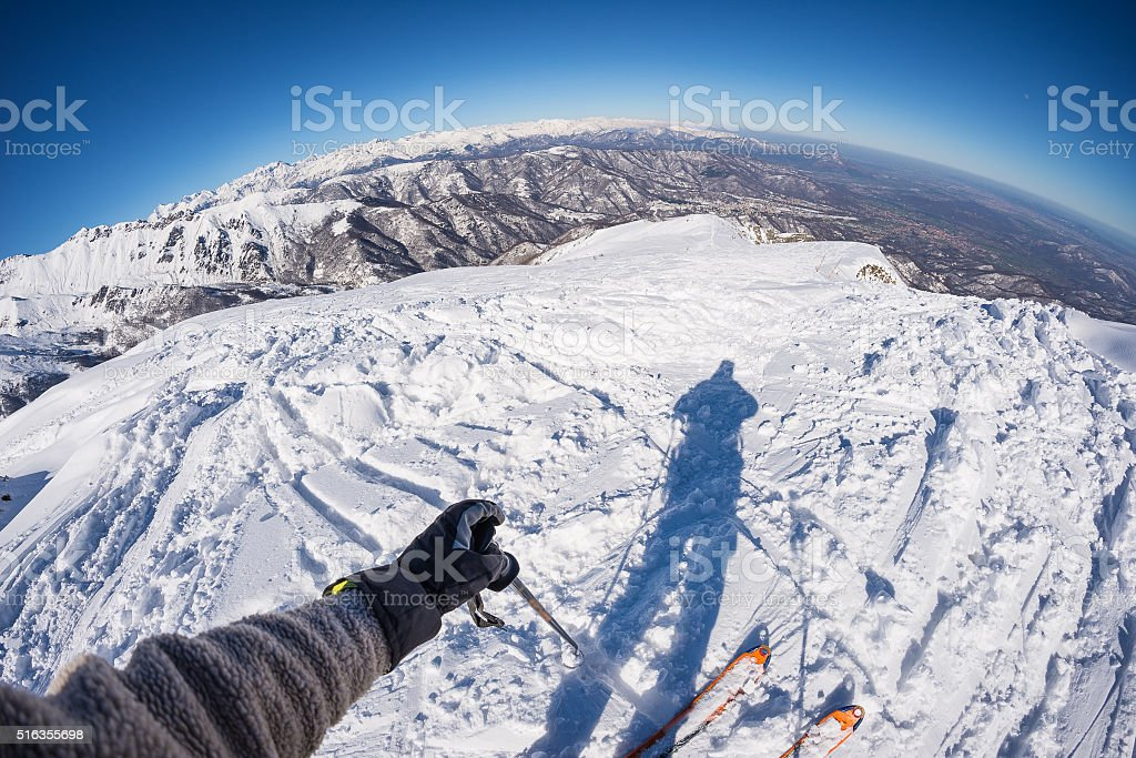 Skiing on the Alps, subjective personal view, fisheye lens stock photo