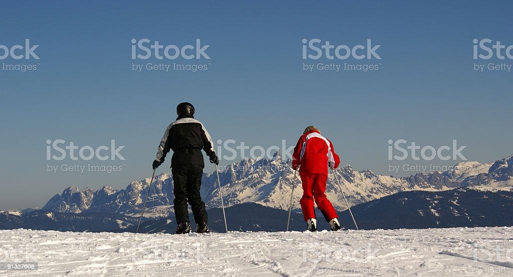 Skiing partners royalty-free stock photo