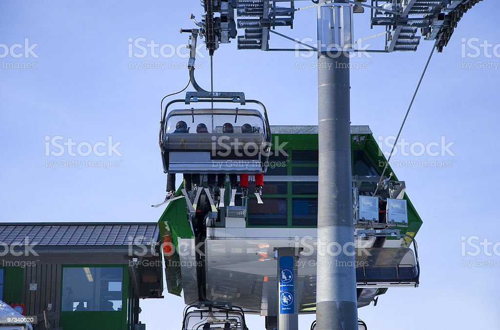 skiing people in ski lift stock photo