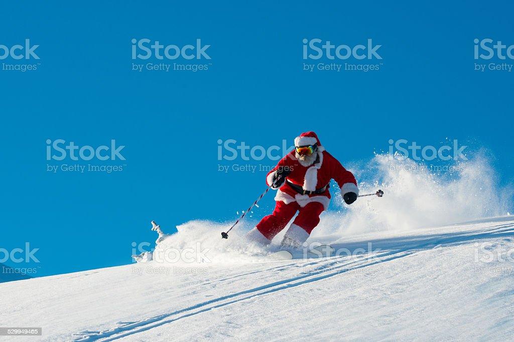 Skiing Santa stock photo