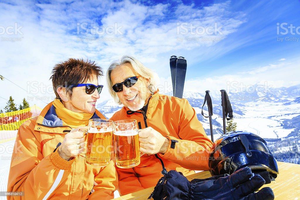skiing senior couple having a break royalty-free stock photo