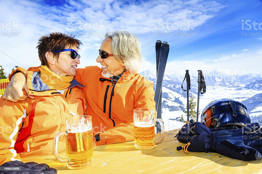 skiing senior couple having a break stock photo