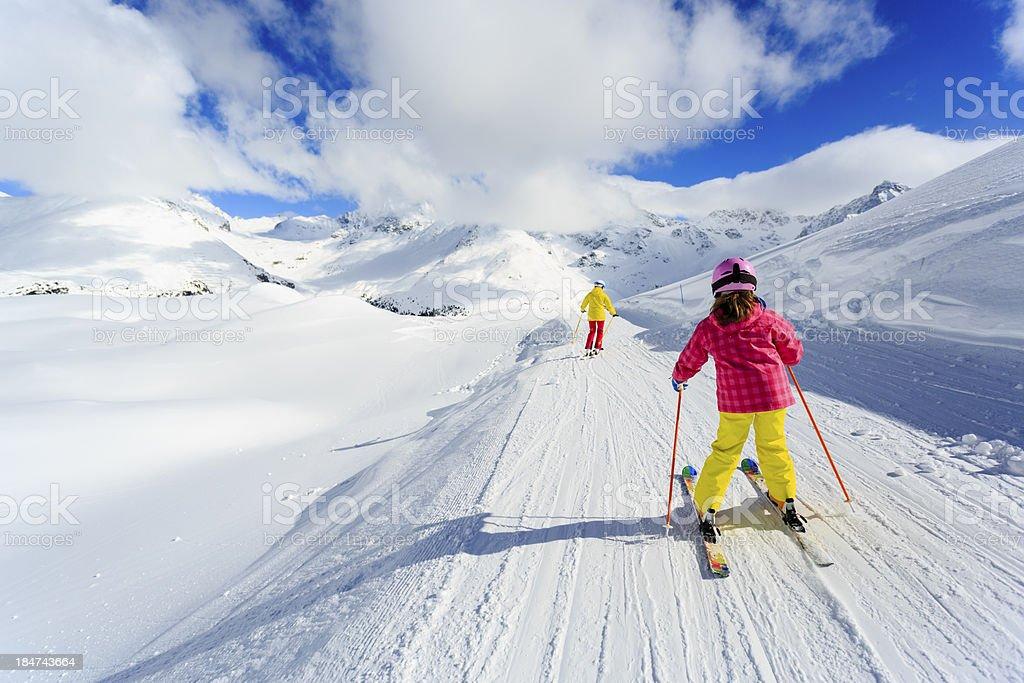 Skiing, skiers on ski run stock photo
