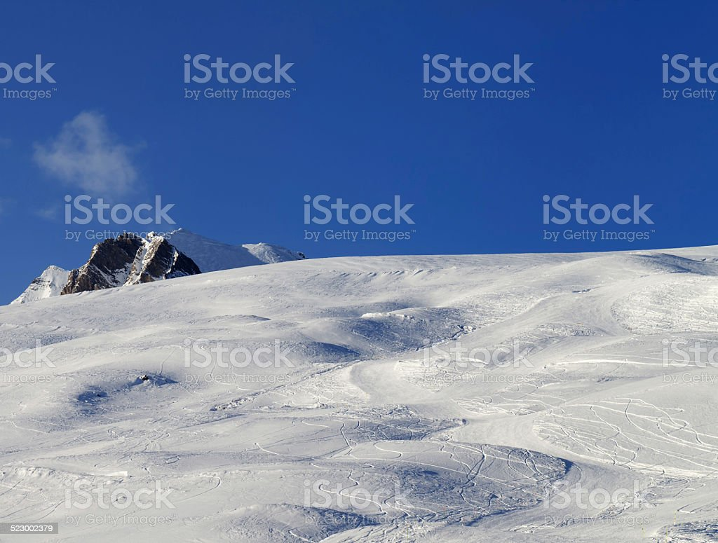 Skiing slope at evening stock photo