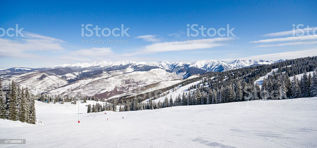 Skiing Slopes and Rocky Mountains stock photo