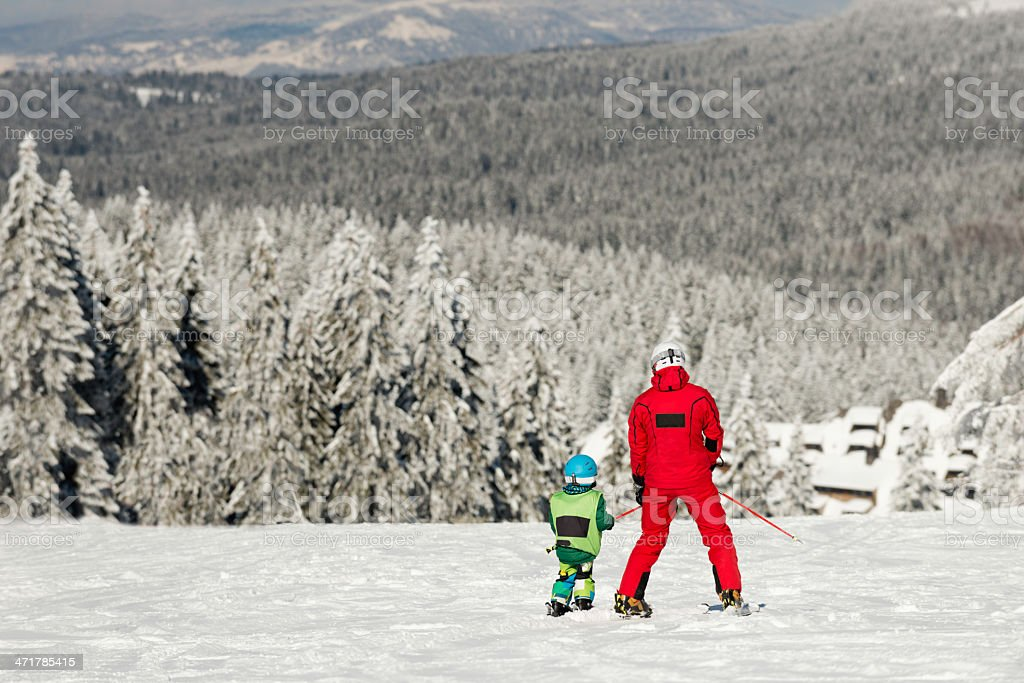 Skiing together royalty-free stock photo