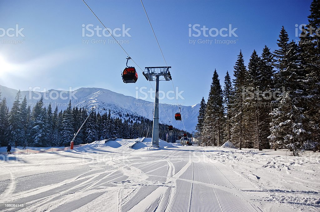 Skiing track and overhead cable cars stock photo