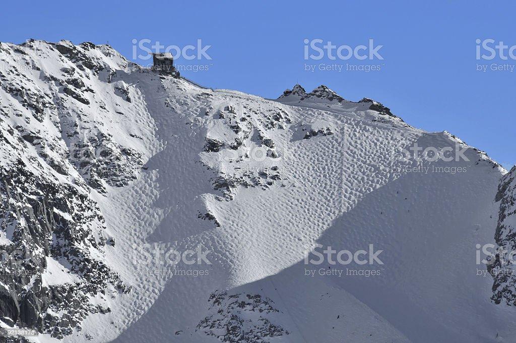 Skiing. Very steep glacier off piste run with moguls stock photo
