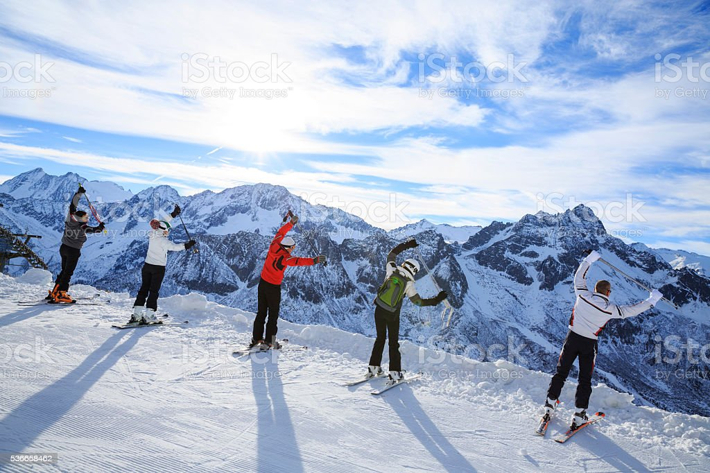 Skiing   Warm Up   Happy skier class on the mountain top stock photo