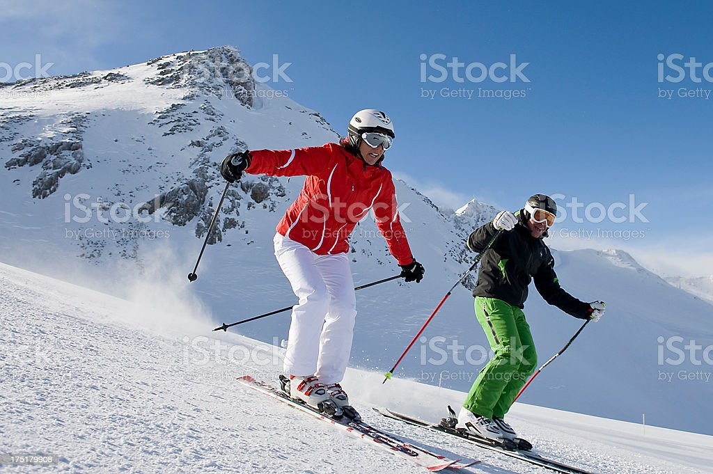 Sporty couple have fun on skiingView other images with these models...