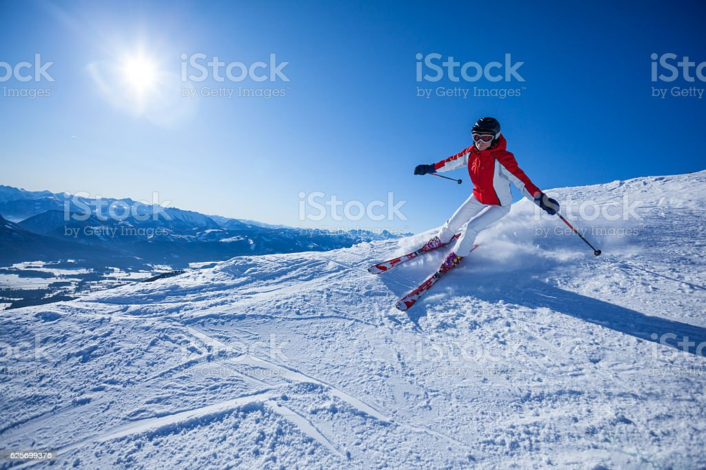 skiing woman on slope stock photo