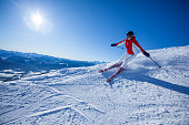 skiing woman on slope