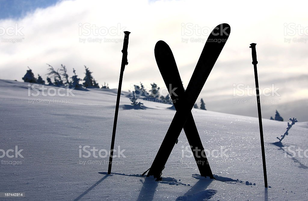 Skiis and Poles Silhouette royalty-free stock photo