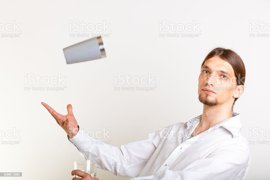Skilled bartender juggling with glass. stock photo