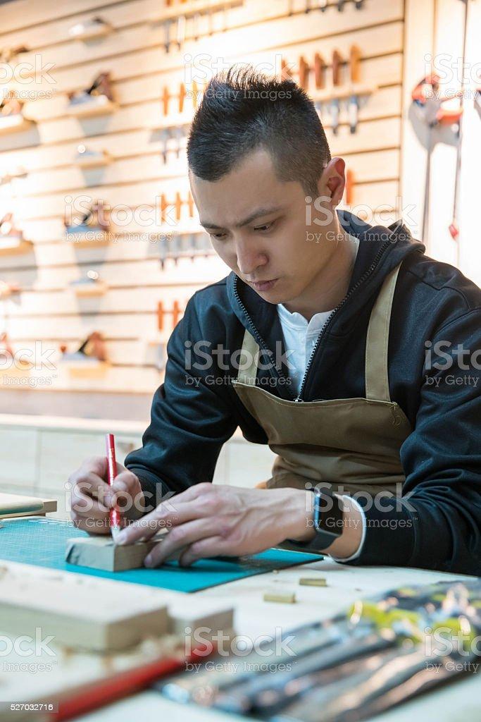 skilled carpenter working stock photo