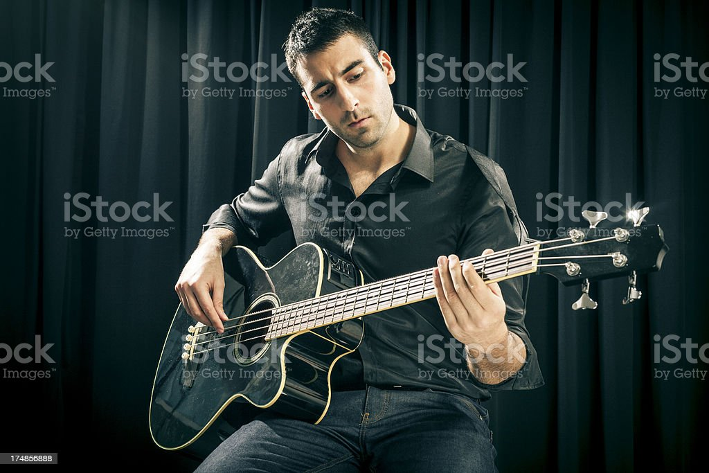 Skilled guitarist royalty-free stock photo