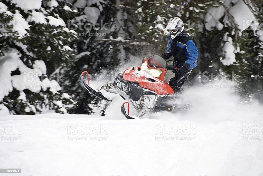 Skilled snowmobile rider stock photo