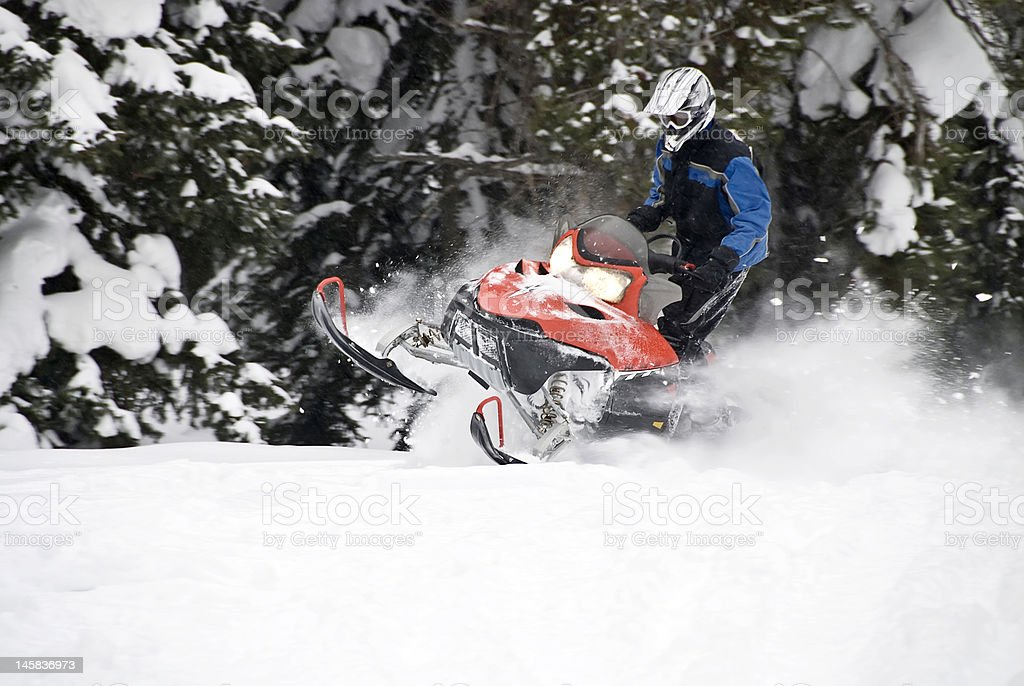 Skilled snowmobile rider stock photo