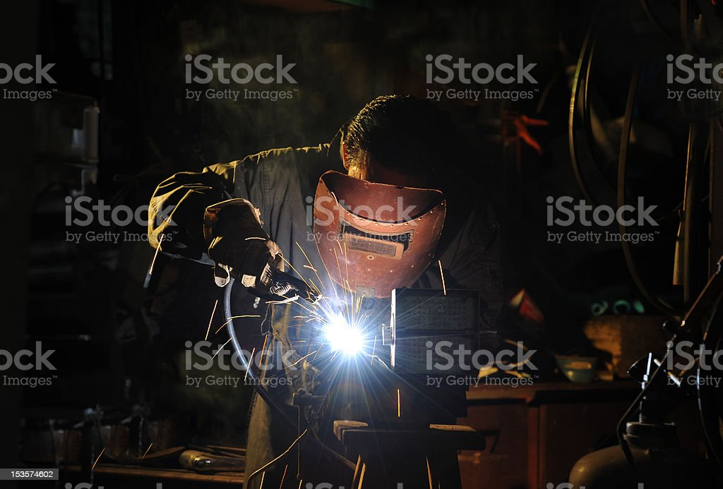 skilled working factory welder royalty-free stock photo