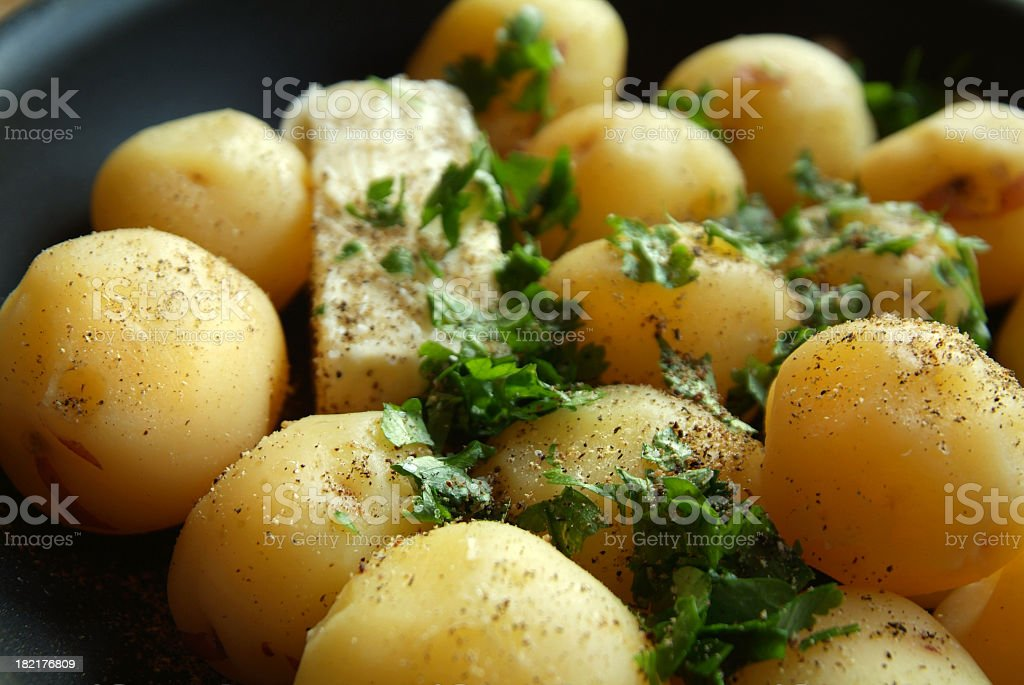 Skillet Full of New Potatoes with Parsley and Butter royalty-free stock photo