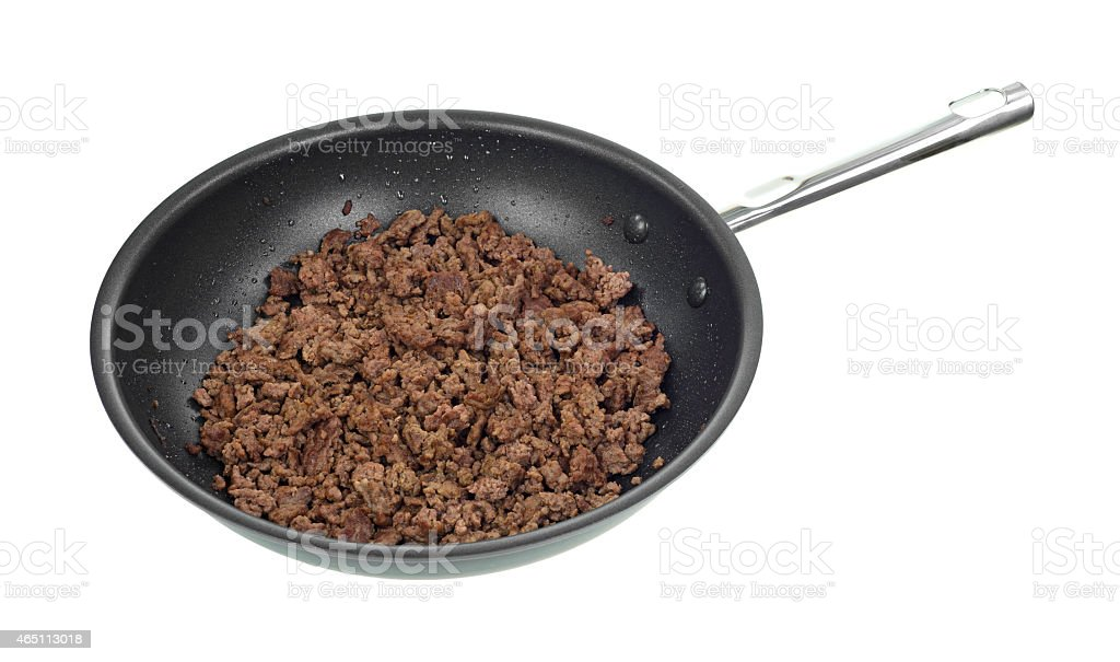 Skillet with cooked ground beef stock photo