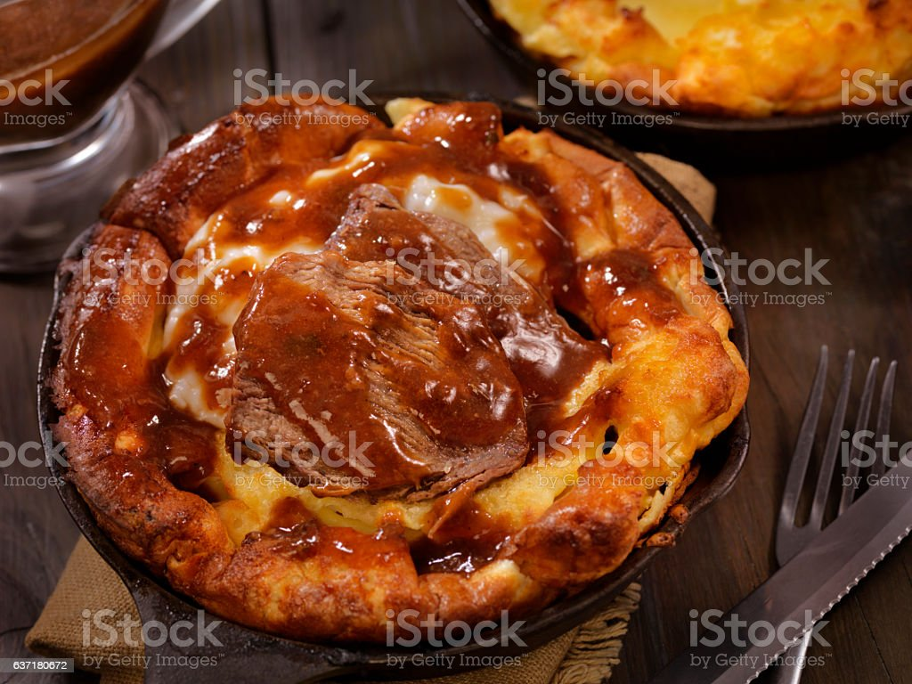Skillet Yorkshire Pudding with Pot Roast and Mashed Potatoes stock photo