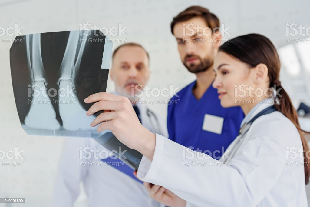 Skillful doctors analyzing x-ray photo stock photo