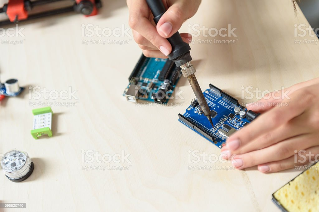 Skillful engineer constructing 3d components stock photo