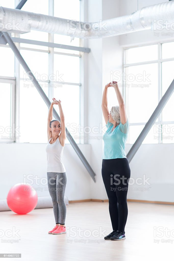 Skillful experienced coach showing the physical exercise stock photo