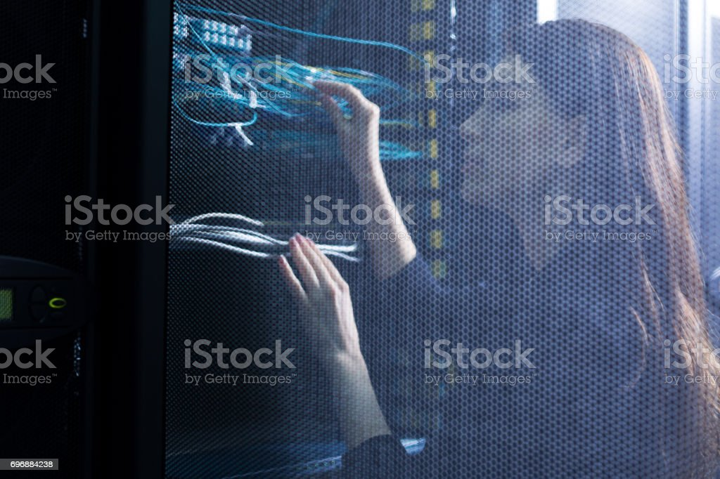 Skillful female engineer checking wires stock photo