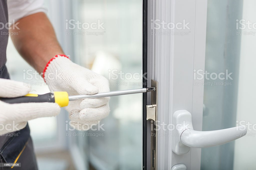 Skillful male builder is working at new building stock photo