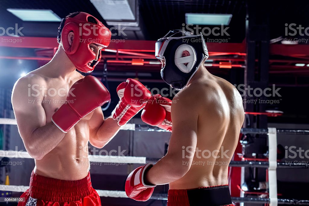 Skillful two opponents are sparing with each other stock photo