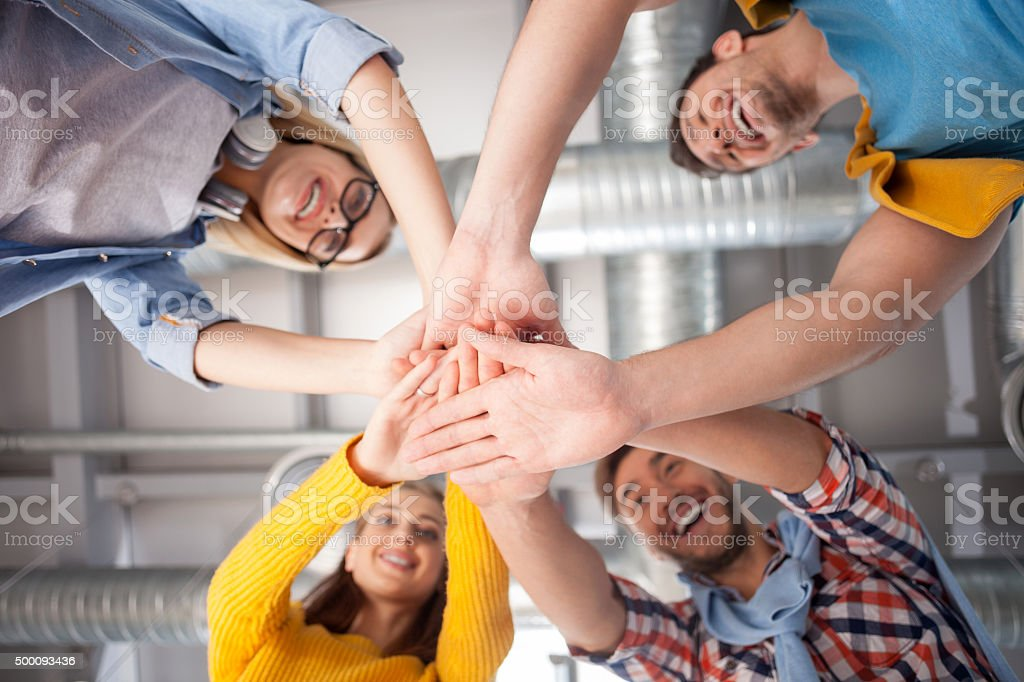 Skillful young colleagues are happy to be together stock photo