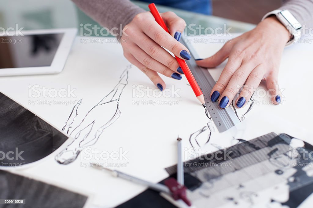 Skillful young designer is creating new project stock photo
