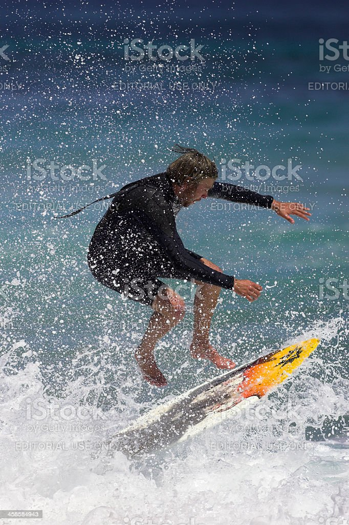 Skimboard Surfer Wipes Out stock photo
