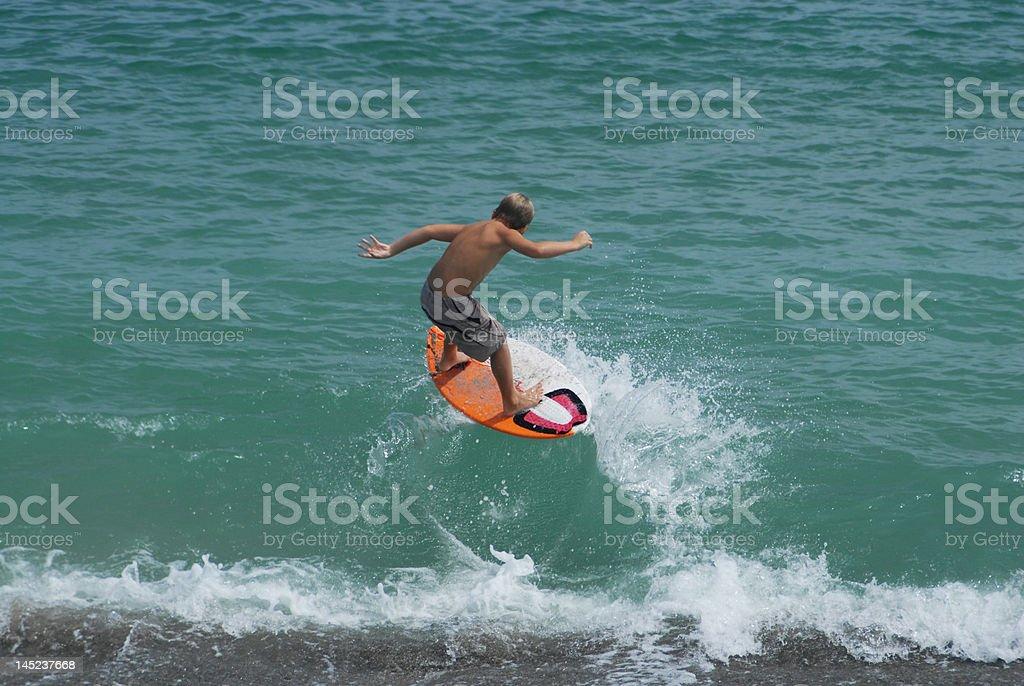 skimboard the wave stock photo