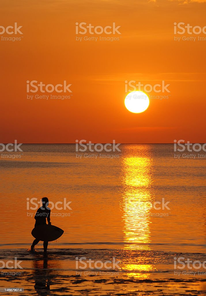 Skimboarder at Sunset stock photo