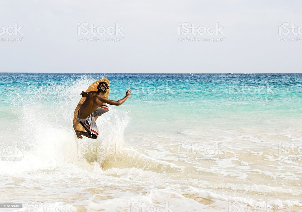 skimboarder jumping wave stock photo