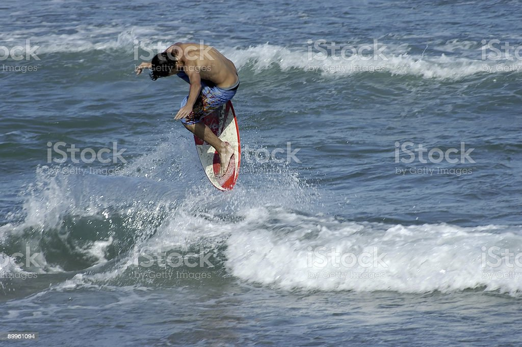 Skimboarder stock photo