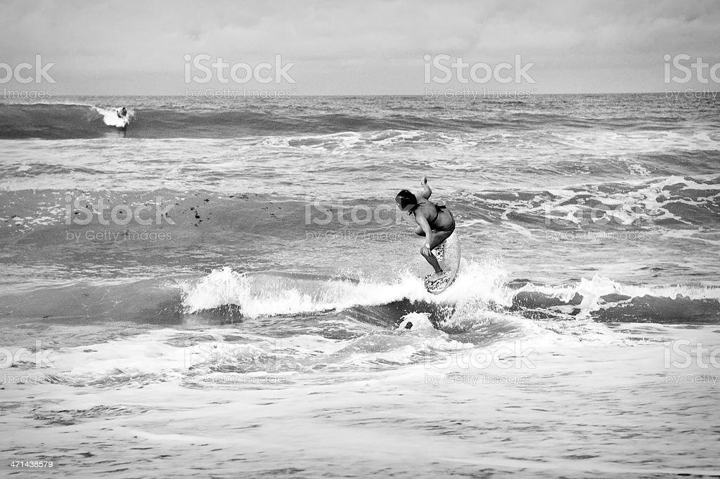 Skimboarding and Surfboarding stock photo
