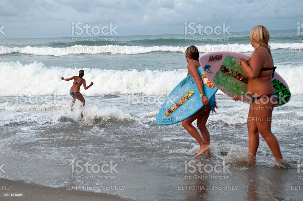 Skimboarding at beach in Indialantic, Florida stock photo